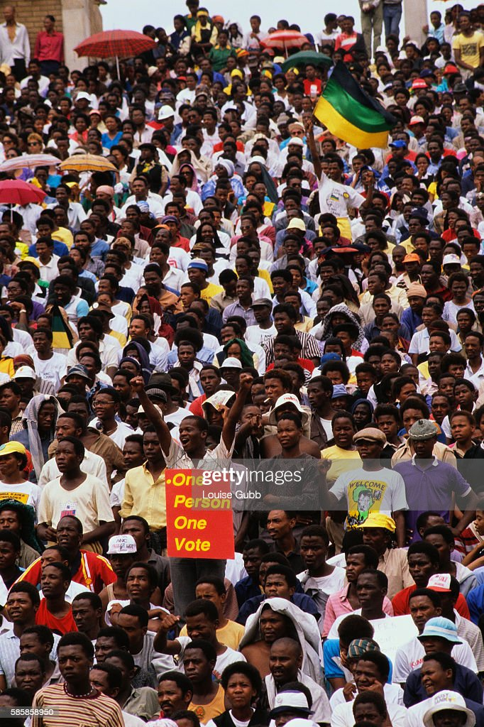 A crowd of Black South Africans gather to celebrate former African National Congress President Nelson Mandela's release from Victor Vester prison...