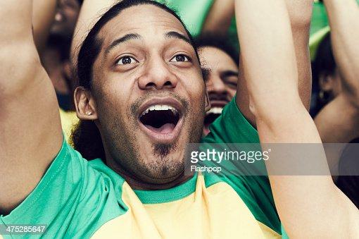 Crowd of Brazilian fans cheering : Stock Photo