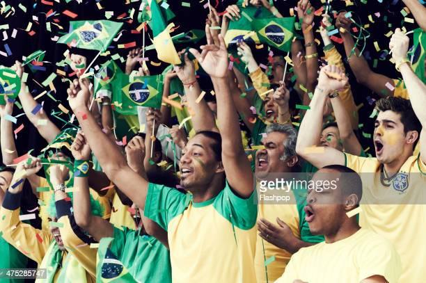 Crowd of Brazilian fans cheering
