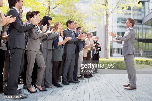 Crowd of business people cheering for businessman : Bildbanksbilder