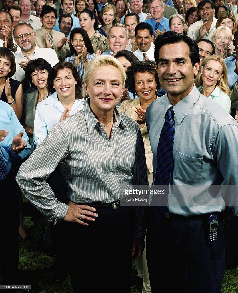 Crowd of business people, two executives in foreground, portrait : Stock Photo