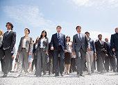 Crowd of business people walking