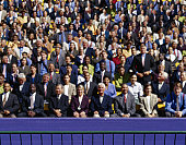 Crowd of Businesspeople in a Grandstand