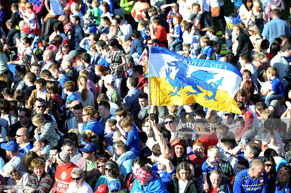 A crowd of Cardiff City fans wait outside Cardiff Castle during the Cardiff City FC victory parade in honour of the football club winning the npower Championship League trophy on May 05, 2013 in Cardiff, Wales.
