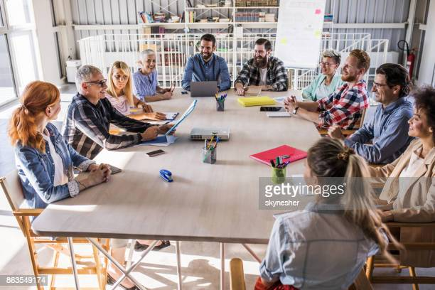 Crowd of casual business people having a constructive meeting in a board room.