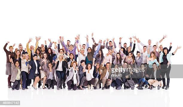 Crowd of cheerful business people with raised hands.