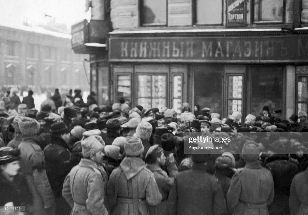 A crowd of civilians gathered in front of a bookstore in Petrograd (St. Petersburg) during the October Revolution in 1917. Soldiers, most likely bolsheviks, can be seen.