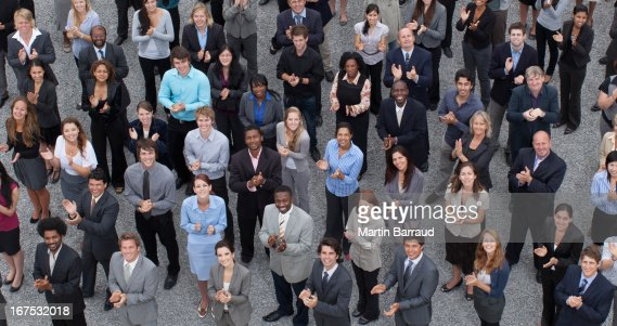 Crowd of clapping business people