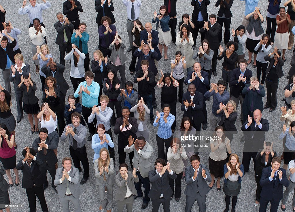 Crowd of clapping business people : Stock Photo