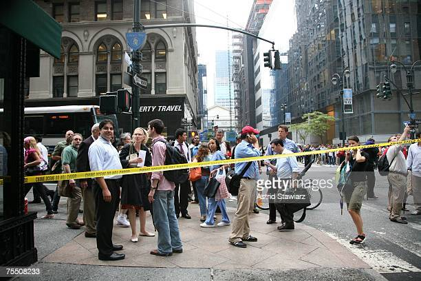 A crowd of concerned pedestrians look from Madison Ave and 41st street over to the direction of a steam pipe explosion that occurred during rush hour...