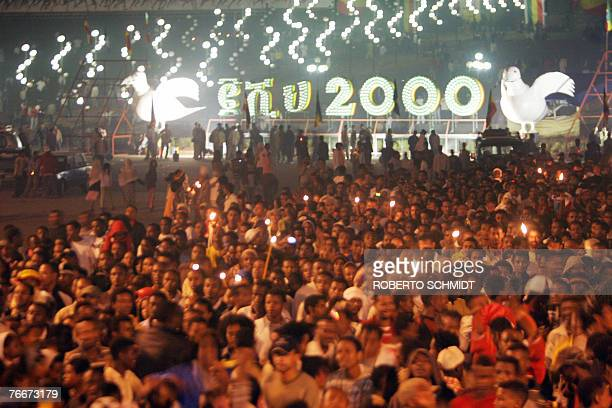 A crowd of Ethiopians jam a square after the stroke of midnight early 12 September 2007 as they celebrate the arrival of their new millenium in Addis...
