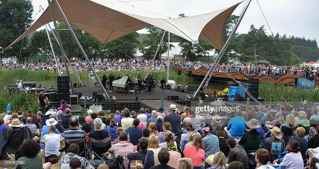 A crowd of festival music fans watch as classical trumpeter Alison Balsom performs on stage with The English Concert on Day 4 of Latitude Festival 2013 at Henham Park Estate on July 21, 2013 in Southwold, England.