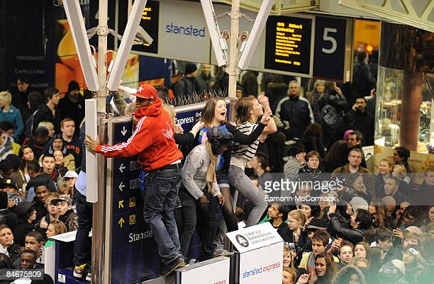 A crowd of flashmob dancers congregates at London Liverpool Street Station on February 06 2009 in London England