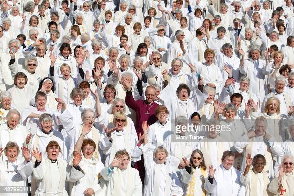 A crowd of hundreds of women priests stand on the steps of St Paul's Cathedral with the Archbishop of Canterbury Justin Welby before going inside for...