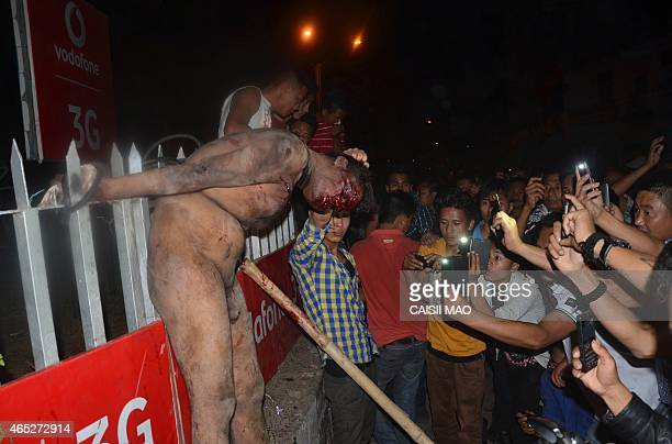 A crowd of Indian men surround an alleged rapist after he was dragged out of prison and beaten to death in Dimapur in the northeastern Indian state...