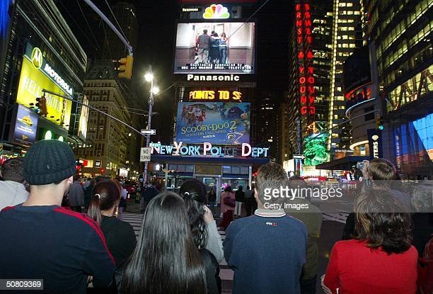 A crowd of New Yorkers watch the 'Friends' finale being broadcast live on the Astrovision video screen in Times Square May 6 2004 in New York City