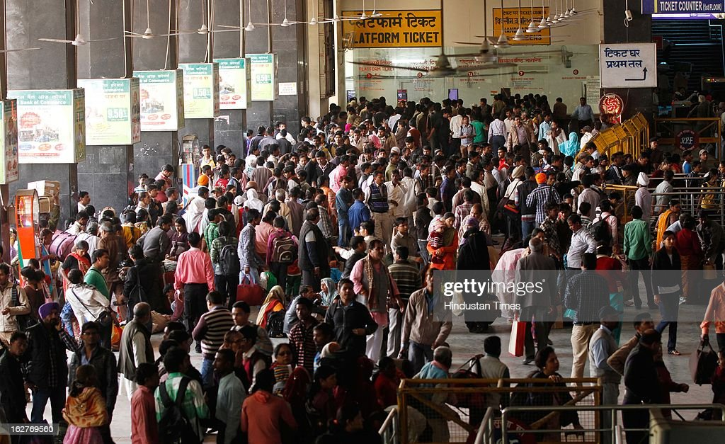 Crowd of passengers at New Delhi Railway Station on February 26, 2013 in New Delhi, India. Indian Railway Minister Pawan Kumar Bansal presented his maiden Railway budget for the next fiscal year in the parliament.