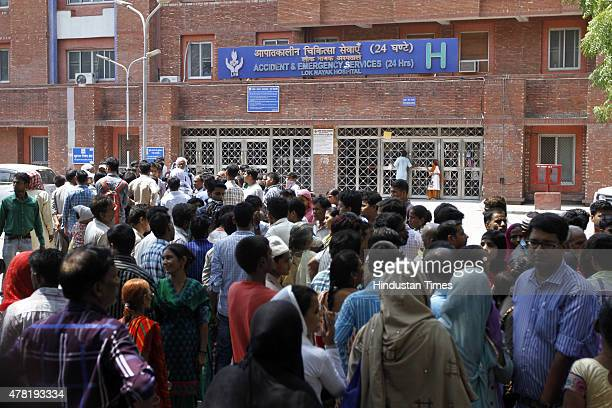 Crowd of patients and their relatives waiting outside the Emergency entry of LNJP Hospital during the second day of the doctors strike to demand...