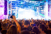 crowd of people at concert or show, abstract blur