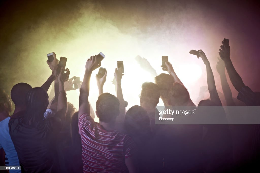 Crowd of people at concert using mobile phones : Stock Photo