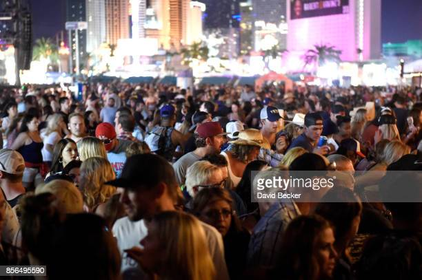 A crowd of people at the Route 91 Harvest country music festival after apparent gun fire was heard on October 1 2017 in Las Vegas Nevada There are...