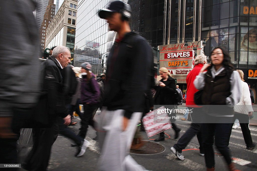 A crowd of people cross the street in midtown Manhattan on October 31, 2011 in New York City. Around the world countries marked the global population reaching seven billion Monday. The UN is using Monday to symbolically mark the day as demographers are not sure exactly when the world's population will reach the seven billion mark.