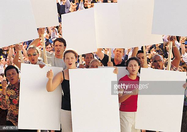 Crowd of people holding blank paper