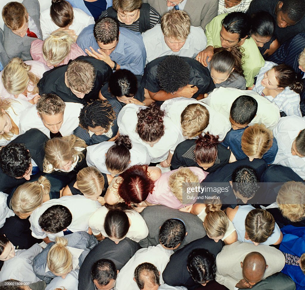 Crowd of people huddled together, overhead view
