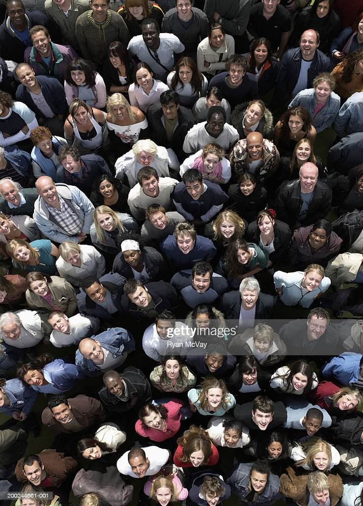 Crowd of people looking upwards, smiling, overhead view : Stock Photo