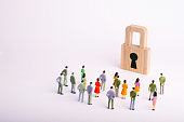 A crowd of people looks at the padlock. The concept of security, cyber-security and privacy of personal data of users. The threat of hacking hackers, draining databases. Viruses. Selective focus