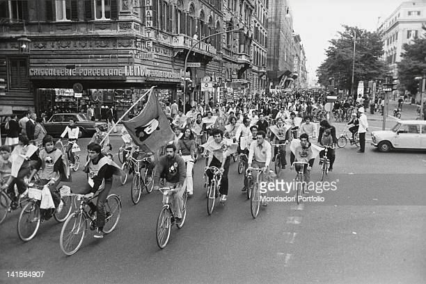 A crowd of people on bikes riding through the streets of Rome during an antinuclear rally promoted by WWF Rome September 1977