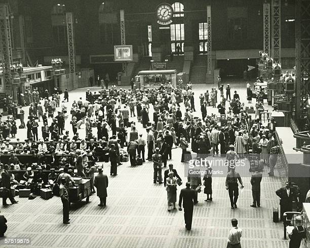 Crowd of people on Penn Station, New York City, (B&W), elevated view