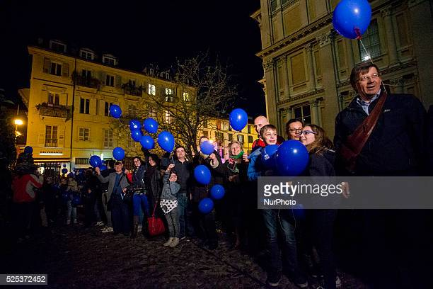 A crowd of people pictured during the World Autism Awareness Day in Turin with the blue balloons symbol of the event