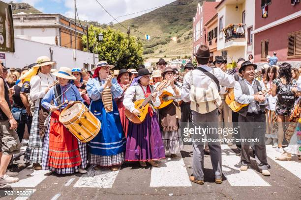 Crowd of people playing musical instruments in band at harvest festival, Tegueste, Canary Islands, Spain