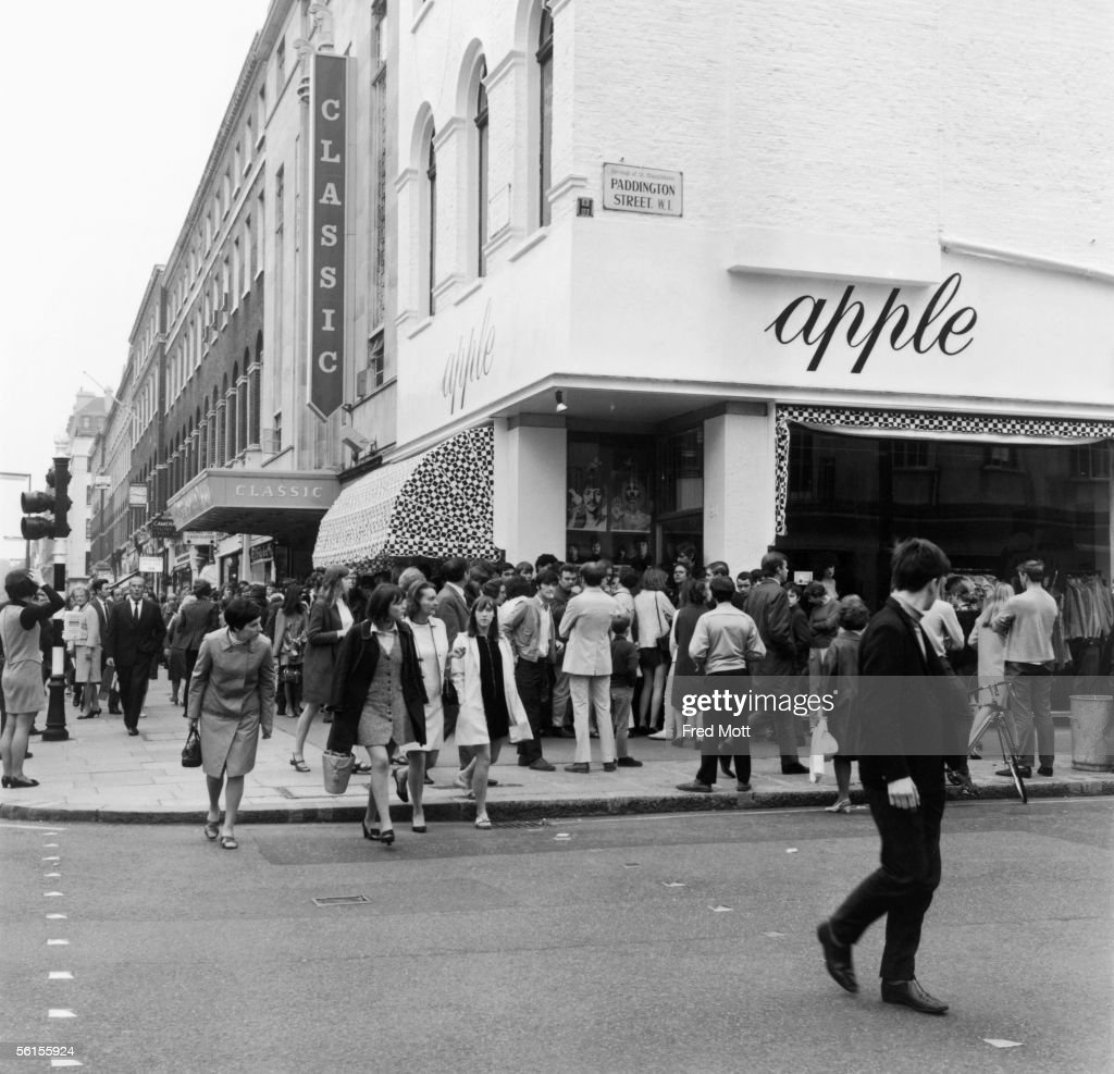 A crowd of people queuing outside The Beatles' boutique 'Apple' on the corner of Baker Street and Paddington Street. The Beatles decided that they were 'sick of being shopkeepers' and ordered that thousands of pounds worth of stock be given away free, 31st July 1968.