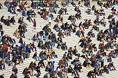 A crowd of people sitting on steps, La Defense