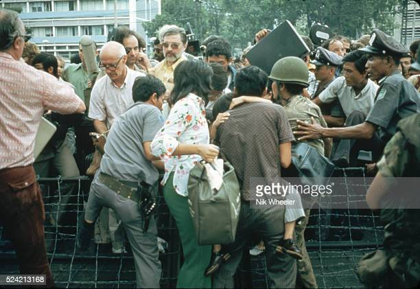 A crowd of people try to force their way into the United States Embassy in Saigon South Vietnam