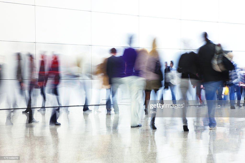 Crowd of People Walking Indoors Down Walkway, Blurred Motion : Stock Photo