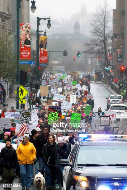 A crowd of protesters receives a police escort from City Hall to Congress Square Park during the March for Science