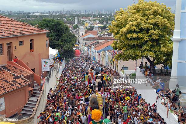 A crowd of revellers take over the streets of Olinda dressed in costumes to play and watch the traditional giant dolls parade as part of the 2010...