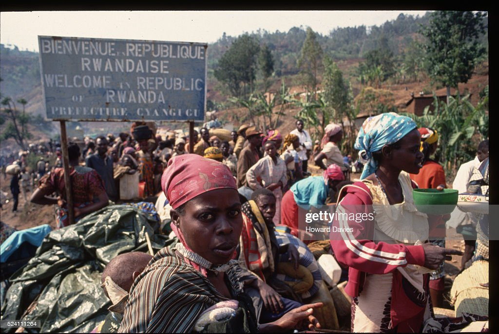 A crowd of Rwandan refugees sit at the border waiting to cross the Ruzizi Bridge into Bukauu. 1994.