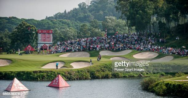 A crowd of spectators watch the players in action during the day four of the WGC HSBC Champions at the Mission Hills Resort on November 04 in...