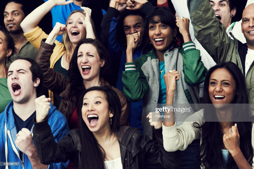 Crowd of sports fans cheering