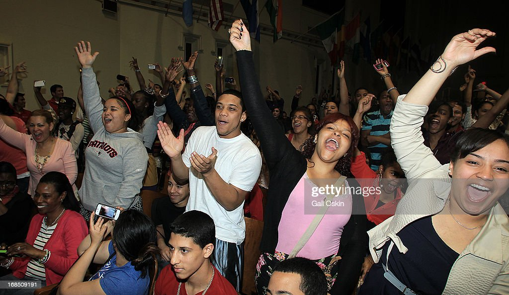 A crowd of students cheer as <a gi-track='captionPersonalityLinkClicked' href=/galleries/search?phrase=Kendrick+Lamar&family=editorial&specificpeople=8012417 ng-click='$event.stopPropagation()'>Kendrick Lamar</a> walks onto the stage while visiting Providence, Rhode Island students with the Get Schooled victory tour at the Mt. Pleasant High School on May 10, 2013 in Providence, Rhode Island.