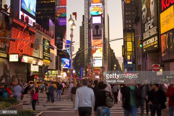 A crowd of tourists take to the streets in Times Square at 7th Ave and Broadway as seen in this 2009 New York NY early evening cityscape photo