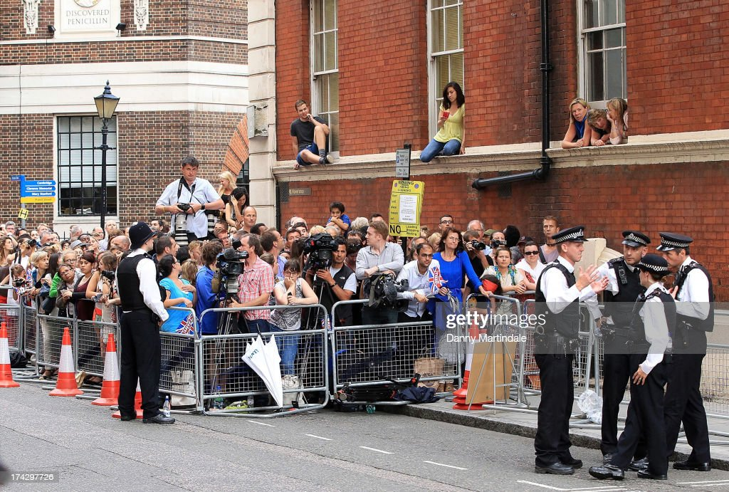 A crowd of wellwishers wait outside St Mary's Hospital ahead of the anticipated departure of Prince William, Duke of Cambridge and Catherine, Duchess of Cambridge with their newborn on July 23, 2013 in London, England. Catherine, Duchess of Cambridge yesterday gave birth to a boy at 16.24 BST and weighing 8lb 6oz, with Prince William, Duke of Cambridge at her side. The baby, as yet unnamed, is third in line to the throne and becomes the Prince of Cambridge.