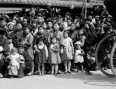 Crowd of women and children waiting for parade Kobe