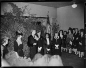 Crowd of women standing in interior with large ferns and American flag for reception Pittsburgh Pennsylvania February 1944 Including First Lady...