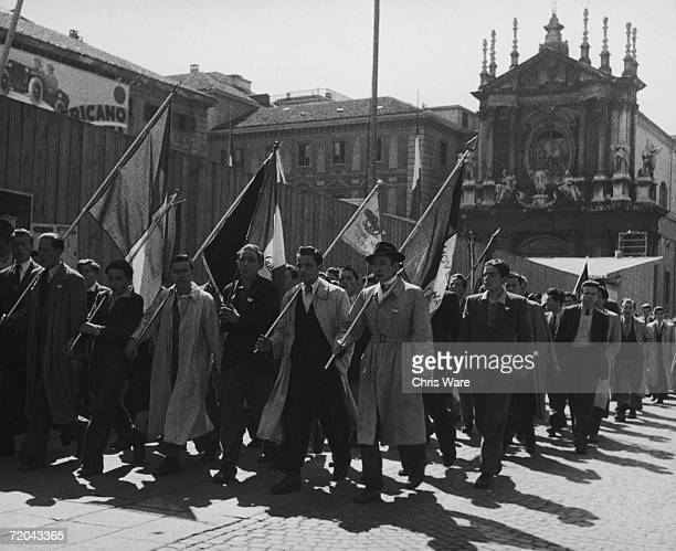 A crowd of young men on a protest march through Turin 20th August 1946
