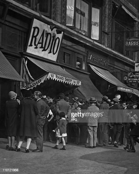 A crowd outside a radio shop USA circa 1925